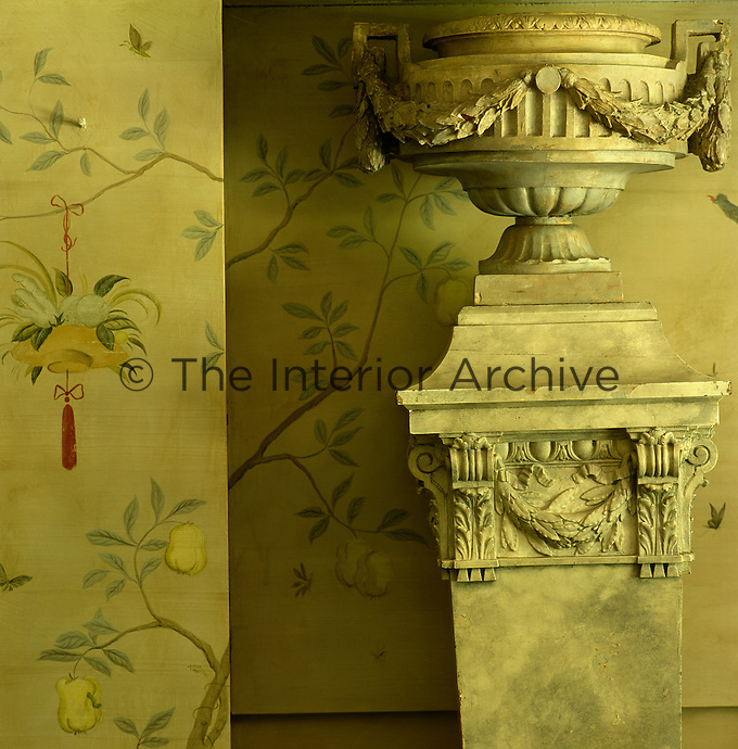 An 18th century French column is topped with a fibreglass reproduction of an old garden urn to bring scale to the dining room
