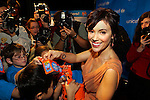 """Alyssa Milano helps raise funds for the """"Trick or Treat for UNICEF"""" campaign."""