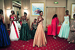 KINSHASA, DEMOCRATIC REPUBLIC OF CONGO APRIL 21: Unidentified contestants in the Miss Congo contest prepare backstage to enter the stage on April 21, 2006 in central Kinshasa, Congo, DRC. About twenty girls from all over Congo, DRC competed to win the crown at the Grand Hotel in Kinshasa. Diane Muzungu from the Katanga province won. Congo DRC, returned to the Miss World contest only in 2005, after almost two decades absence. Kinshasa, a city of about eight million people is battling with bad infrastructure and no public transport. Congo, DRC is in ruins after forty years of mismanagement by the corrupt dictator and former president Mobuto Sese Seko. He fled the country in 1997 and a civil war started. The country is planning to hold general elections by July 2006, the first democratic elections in forty years.(Photo by Per-Anders Pettersson)