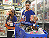 "Calvin de Haan of the New York Islanders and Brittany DaSilva fill their cart with presents at Toys ""R"" Us in Carle Place during the team's holiday shopping for children in hospitals on Thursday, Nov. 30, 2017. The gifts will be hand-delivered by the players to children in eight local hospitals on Monday, Dec. 18."