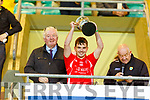 East Kerry captain Peter McCarthy accepts the Acorn Life    U21 Football Championship Cup from Diarmuid O'Se (Kerry Co Comm) and Pius Horgan (Acorn Life)
