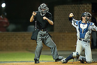 The home plate umpire makes a strike call during the NCAA baseball game between the Catawba Indians and the Belmont Abbey Crusaders at Abbey Yard on February 7, 2017 in Belmont, North Carolina.  The Crusaders defeated the Indians 12-9.  (Brian Westerholt/Four Seam Images)