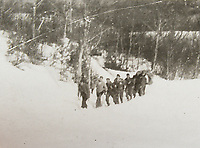 BNPS.co.uk (01202 558833)<br /> Pic: HannBooks/BNPS<br /> <br /> PICTURED: Memebers of the SAS party behind enemy lines fleeing from the Germans.<br /> <br /> Remarkable photos taken deep behind enemy lines by an SAS unit during a daring wartime operation have come to light on the 75th anniversary of the mission. <br />  <br /> The little-known Operation Galia on the 27th December 1944 involved just 33 SAS men hoodwinking the Nazis and their fascist allies into thinking a much greater force had landed behind them in Italy in December 1944.<br />  <br /> Adolf Hitler's forces had just launched a major surprise offensive in the Ardennes Forest in Belgium that became known as the Battle of the Bulge.<br /> <br /> Robert Hann, whose late father was SAS Paratrooper Stanley Hann, retraced his father's wartime experiences and part of his [father's] epic 80 mile long escape route through the Apennine mountains which the men took, to help him write the book 'SAS Operation Galia.'
