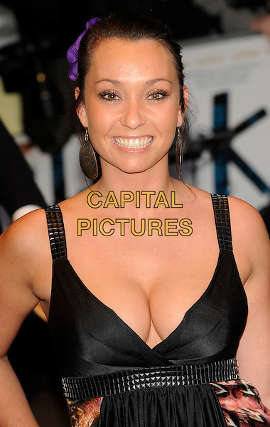 LUCINDA RHODES FLAHERTY .'The Kid'  UK premiere held at the Odeon West End, Leicester Square, London, England, 15th September 2010..portrait headshot black cleavage boobs smiling low cut studded studs straps .CAP/CJ.©Chris Joseph/Capital Pictures
