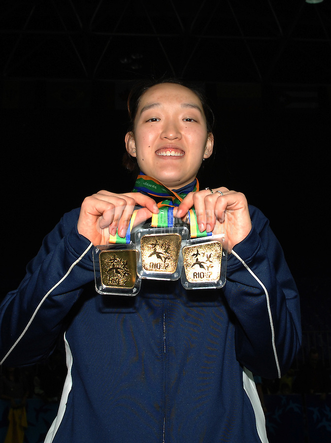 Jul 19, 2007; Rio de Janeiro, Brazil; Eva Lee (USA) celebrates with her three gold medals after getting her third gold by defeating Canada in the mixed doubles badminton final in the Pan American Games at the Rio Centro Pavilion in Rio de Janeiro. Mandatory Credit: Mark J. Rebilas-US PRESSWIRE Copyright © 2007 Mark J. Rebilas