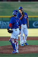 AZL Cubs 1 relief pitcher Pablo Ochoa (43) talks to catcher Richard Nunez (5) during an Arizona League game against the AZL Athletics Gold at Sloan Park on June 20, 2019 in Mesa, Arizona. AZL Athletics Gold defeated AZL Cubs 1 21-3. (Zachary Lucy/Four Seam Images)
