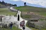 The peloton tackle sector 5 Lucignano d'Asso during the Strade Bianche 2019 running 184km from Siena to Siena, held over the white gravel roads of Tuscany, Italy. 9th March 2019.<br /> Picture: LaPresse/Fabio Ferrari | Cyclefile<br /> <br /> <br /> All photos usage must carry mandatory copyright credit (© Cyclefile | LaPresse/Fabio Ferrari)