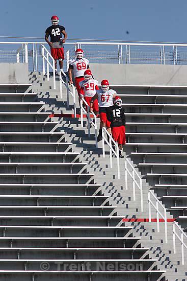 Salt Lake City - Salt Lake City - at University of Utah college football practice Thursday March 12, 2009 at Rice-Eccles Stadium. players walking stairs.
