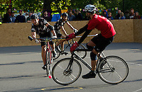 17 AUG 2014 - LONDON, GBR - A Triple Jay player (in black patterned top) attempts a shot past a Mondial player a the 2014 London Open Bike Polo tournament in Highbury Fields in London, Great Britain (PHOTO COPYRIGHT © 2014 NIGEL FARROW, ALL RIGHTS RESERVED)