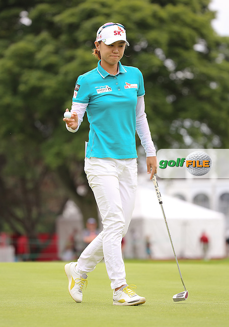 24 August 14 Na Yeon Choi sinks another putt with her  vintage Bobby Grace putter during Sundays Final Round of The CP Women's Open at The London Hunt and Country Club in London, Ontario, Canada.(photo credit : kenneth e. dennis/kendennisphoto.com)