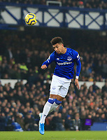 26th December 2019; Goodison Park, Liverpool, Merseyside, England; English Premier League Football, Everton versus Burnley; Mason Holgate of Everton heads the ball clear - Strictly Editorial Use Only. No use with unauthorized audio, video, data, fixture lists, club/league logos or 'live' services. Online in-match use limited to 120 images, no video emulation. No use in betting, games or single club/league/player publications