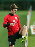 Pictured: Ben Davies jumps over a board. Monday 02 October 2017<br /> Re: Wales football training, ahead of their FIFA Word Cup 2018 qualifier against Georgia, Vale Resort, near Cardiff, Wales, UK.