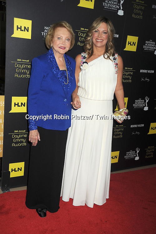 Lee Phillip Bell and Maria Arena Bell attends the 39th Annual Daytime Emmy Awards on June 23, 2012 at the Beverly Hilton in Beverly Hills, California. The awards were broadcast on HLN.
