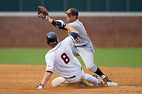 Shortstop Gregory Fujii #2 of the VCU Rams waits for the throw as John Hicks #8 of the Virginia Cavaliers steals second base at the Charlottesville Regional of the 2010 College World Series at Davenport Field on June 4, 2010, in Charlottesville, Virginia.  The Cavaliers defeated the Rams 14-5.  Photo by Brian Westerholt / Four Seam Images