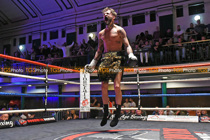 Josh Kennedy (black/gold shorts) defeats Jamie Speight during a Boxing Show at York Hall on 3rd December 2016