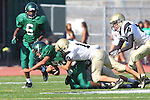 Torrance, CA 10/06/11 - Andrew Phillips (Peninsula #11) in action during the Peninsula vs South Torrance Frosh football game.