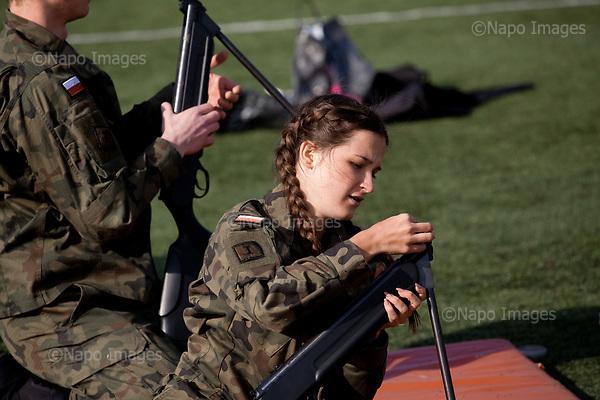 RADOM, POLAND, 28/02/2017:<br /> At the XI Stanislaw Staszic Lycee in Radom, schoolboys and schoolgirls from special classes with military orientation are having a military lesson, during which they learn to drill, a fight, workout and shooting with a pnematic rifle. <br /> (Photo by Piotr Malecki / Napo Images)   <br /> ###<br /> RADOM, 28/02/2017:<br /> Cwiczenia klas mundurowych w XI LO im. Stanislawa Staszica w Radomiu. Klasy takie maja zarowno zwykle szkolne zajecia jak i wiele lekcji przygotowujacych uczniow do zawodow policjanta, zolnierza, lub sluzby w jednostkach obrony terytorialnej.<br /> Fot: Piotr Malecki<br /> <br /> ###ZDJECIE MOZE BYC UZYTE W KONTEKSCIE NIEOBRAZAJACYM OSOB PRZEDSTAWIONYCH NA FOTOGRAFII###