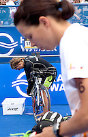 17 JUL 2011 - HAMBURG, GER - Rachel Klamer (NED) (back) and Danne Boterenbrood (NED) prepare in transition for the start of the women's Hamburg round of triathlon's ITU World Championship Series (PHOTO (C) NIGEL FARROW)