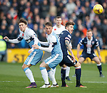 Josh WIndass, Joe Garner and Christopher Routis look for the ball