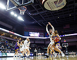 SIOUX FALLS, SD - MARCH 8: Olivia Kaufmann #13 of the Western Illinois Leathernecks drives to the basket against Montserrat Brotons #24 of the Oral Roberts Golden Eagles at the 2020 Summit League Basketball Championship in Sioux Falls, SD. (Photo by Richard Carlson/Inertia)