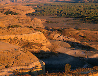 NDTR_114 - USA, North Dakota, Theodore Roosevelt National Park, Evening light on sedimentary hills and valley of the Little Missouri River, view east from River Bend Overlook, North Unit