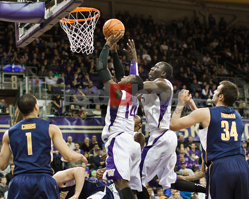 Aziz N'Diaye, Tony Wroten..---Washington Huskies men's basketball against the California Golden Bears at Alaska Airlines Arena at Hec Edmundson Pavilion in Seattle on Thursday, January 19, 2012. (Photo by Dan DeLong/Red Box Pictures)