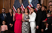 United States Representative Alexandria Ocasio-Cortez (Democrat of New York) poses for a mock swearing-in photo with Speaker of the US House of Representatives Nancy Pelosi (Democrat of California) and members of her family as the 116th Congress convenes for its opening session in the US Capitol in Washington, DC on Thursday, January 3, 2019.<br /> Credit: Ron Sachs / CNP<br /> (RESTRICTION: NO New York or New Jersey Newspapers or newspapers within a 75 mile radius of New York City)