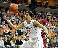 Virginia forward Anthony Gill (13) goes after the loose ball with Florida State center Michael Ojo (50) during the second half of an NCAA basketball game Saturday Jan. 18, 2014 in Charlottesville, VA. Virginia defeated Florida State 78-66. (AP Photo/Andrew Shurtleff)