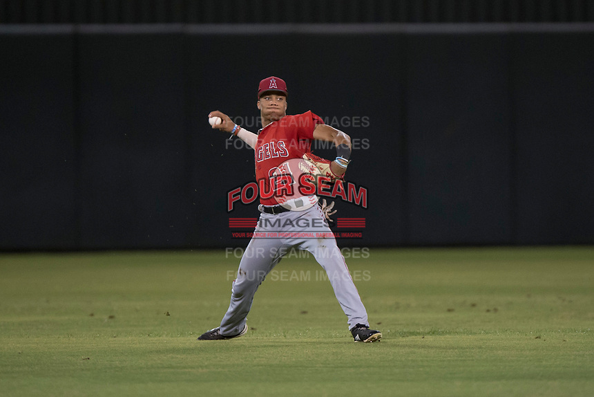 AZL Angels center fielder Jordyn Adams (21) prepares to make a throw to the infield during an Arizona League game against the AZL Padres 2 at Tempe Diablo Stadium on July 18, 2018 in Tempe, Arizona. The AZL Padres 2 defeated the AZL Angels 8-1. (Zachary Lucy/Four Seam Images)