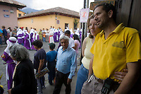 The Procesión La Reseña moves through Espiritu Santo in Antigua, Guatemala. Easter week in Guatemala features lavish, devoted celebrations and throngs of tourists travel to Antigua for the occasion. (Pictured at right is Fernando at his Fernando's Kaffe.)
