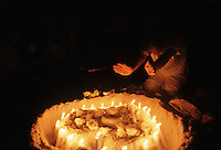Religion ceremony in Latin America, Brazil. Umbanda, African-American religious rituals. Religious fervour, candles, faith. Offerings to the Afro-Brazilian cultural traditions entities during New Year celebration at Copacabana beach, Rio de Janeiro.