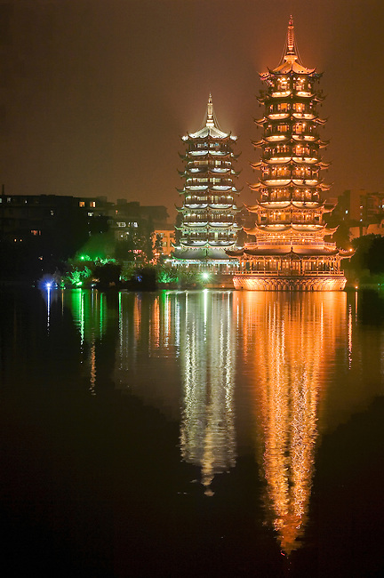 The Sun and Moon Pagodas, Riming Shauang Ta, on east side of Shanhu are lit at night; they are built in antique style.