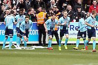 Omar Boggle of Grimsby Town (2nd left) celebrates scoring with team mates during the Vanarama National League match between Dover Athletic and Grimsby Town at the Crabble Athletic Ground, Dover, England on 16 April 2016. Photo by Tony Fowles.