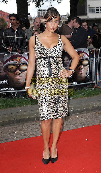 "JAVINE HYLTON.attending the UK Premiere of ""Hancock"" in Leicester Square, London, England,.18th June 2008.full length leopard print dress hand on hip black shoes bow ribbon .CAP/BEL.©Tom Belcher/Capital Pictures"