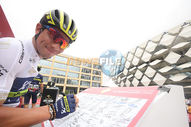 Caleb Ewan (AUS) Orica-Scott at sign on before the start of Stage 3 Al Maryah Island Stage of the 2017 Abu Dhabi Tour, starting at Al Ain and running 186km to the mountain top finish at Jebel Hafeet, Abu Dhabi. 25th February 2017<br /> Picture: ANSA/Claudio Peri | Newsfile<br /> <br /> <br /> All photos usage must carry mandatory copyright credit (&copy; Newsfile | ANSA)