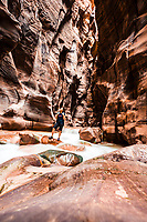 """A hiker inside spectacular Wadi Mujib canyon, Jordan <br /> This river canyon which enters the Dead Sea c 420 metres (1,380 ft) below sea level is also """"almost certainly"""" the biblical Arnon Stream."""