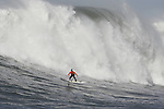 South African Chris Bertish (orange) won the $50,000 first prize on day when several contestants lost control on monster faces and a rogue wave swept over spectators, injuring 13 and causing complete chaos.