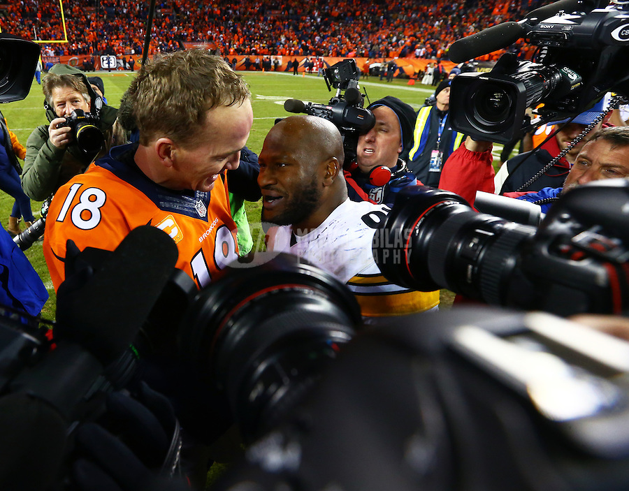 Jan 17, 2016; Denver, CO, USA; Pittsburgh Steelers linebacker James Harrison (92) greets Denver Broncos quarterback Peyton Manning (18) following the AFC Divisional round playoff game at Sports Authority Field at Mile High. Mandatory Credit: Mark J. Rebilas-USA TODAY Sports