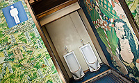 Japanese male public toilet with tradition art work decoration.