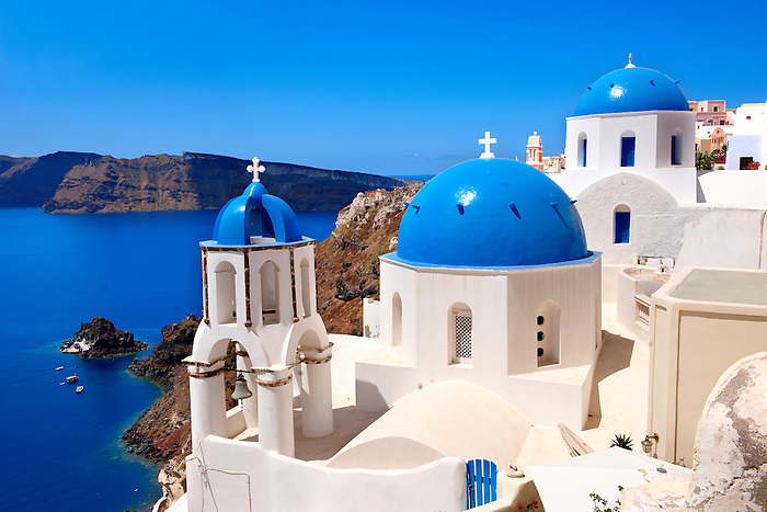 Oia, ( Ia )  Santorini - Blue domed Byzantine Orthodax churches, - Greek Cyclades islands - Photos, pictures and images