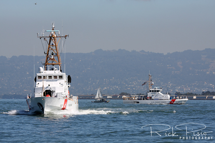 The 110 foot United States Coast Guard Cutter 'Orcas' (WPB1327) and the 87 foot cutter 'Hawksbill' on San Francisco Bay.
