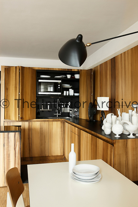 The partially closed sliding doors hide the kitchen sink and shelves above