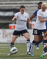 Seattle Reign FC forward Elizabeth Bogus (5) controls ball for shot. In a National Women's Soccer League (NWSL) match, Seattle Reign FC (white) defeated Boston Breakers (blue), 2-1, at Dilboy Stadium on June 26, 2013.
