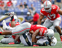 Ohio State Buckeyes linebacker Darron Lee (43) knocks Navy Midshipmen quarterback Keenan Reynolds (19) to the ground on a run in the 3rd quarter of their NCAA game at M&T Bank Stadium in Baltimore, Maryland on August 30, 2014. (Dispatch photo by Kyle Robertson)