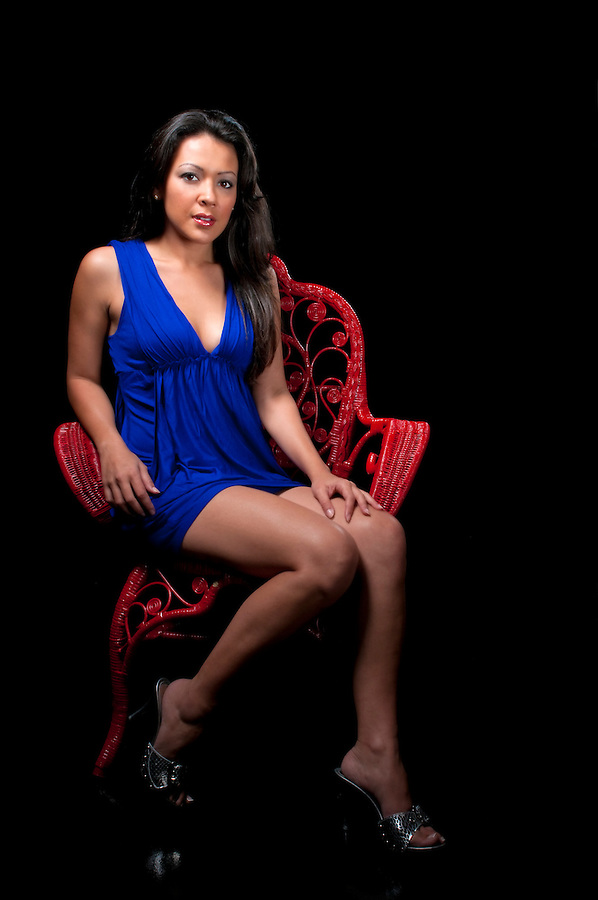 Sensual girl seated in dim light with night dress. Space for copy.