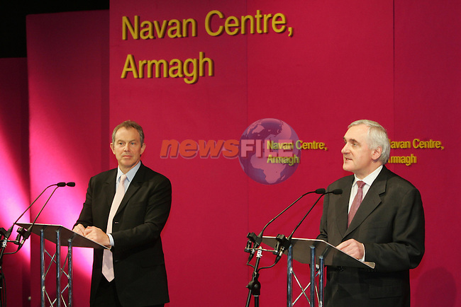 Navan Centre, Armagh,Northern Ireland. Irish Prime Minister Bertie Ahern T.D.(R) and British Prime Minister Tony Blair M.P. (L) speaking at a Joint press conference  on the Northern Executive at the Navan Centre outside Armagh in Northern Ireland 6/4/06.Photo AFP/NEWSFILE/Fran Caffrey..(Photo credit should read Fran Caffrey/NEWSFILE).