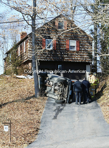 SOUTHBURY, CT, 03/06/07- 030607BZ02- <br /> Southbury Volunteer Firefighters and Southbury Police investigate the scene of a  rollover at 49 Jeremy Swamp Rd. in Southbury Tuesday afternoon.<br /> Jamison C. Bazinet Republican-American