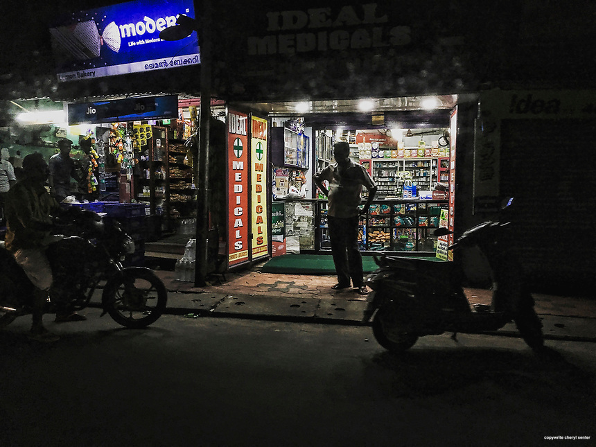 A storekeeper stands outside his shop at night in Thiruvananthapuram, India,  June 6, 2017 (Cellphone Photo by Cheryl Senter)