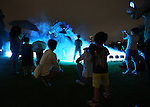 July 18, 2014, Tokyo, Japan - Visitors look at a 6.6 meter tall replica model of Godzilla at Tokyo Midtown in downtown Tokyo on Friday, July 18, 2014. The Godzilla display runs from July 18 to August 31. (Photo by AFLO)