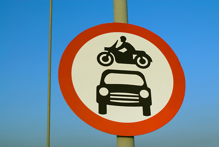 A bike flying over a car